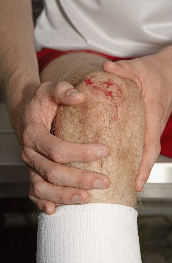 Soccer Player Holding Injured Knee